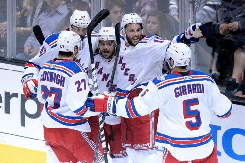 LOS ANGELES, CA - JUNE 07: (C) Mats Zuccarello #36 of the New York Rangers celebrates his goal with teammates Dan Girardi #5, Ryan McDonagh #27 and Derick Brassard #16 and Benoit Pouliot #67 in the first period during Game Two of the 2014 NHL Stanley Cup Final at the Staples Center on June 7, 2014 in Los Angeles, California.   Kevork Djansezian/Getty Images/AFP == FOR NEWSPAPERS, INTERNET, TELCOS & TELEVISION USE ONLY ==